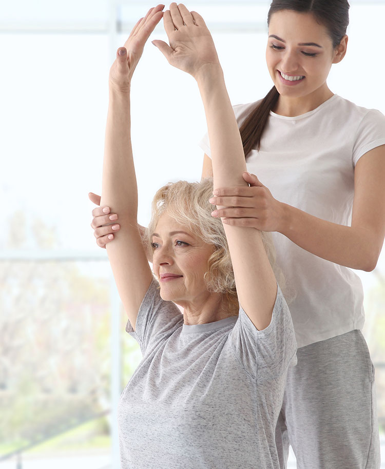 Physiotherapist-working-with-elderly-patient-in-modern-clinic